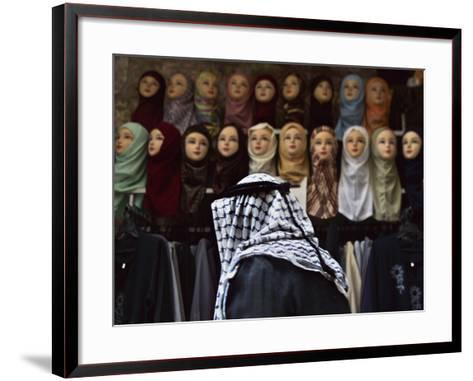 Palestinian Man Passes in Front of a Shop Offering Veils for Sale in Jerusalem's Old City--Framed Art Print