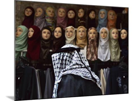 Palestinian Man Passes in Front of a Shop Offering Veils for Sale in Jerusalem's Old City--Mounted Photographic Print