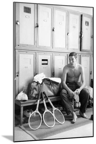 Nicola Pietrangeli in a Changing Room, with Rackets and a Sport Bag--Mounted Photographic Print