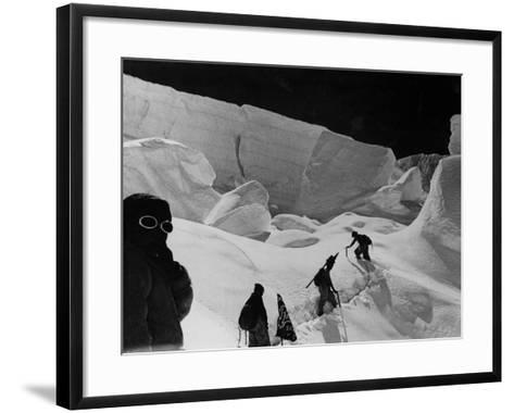 Alpinists Walking in the Snow--Framed Art Print