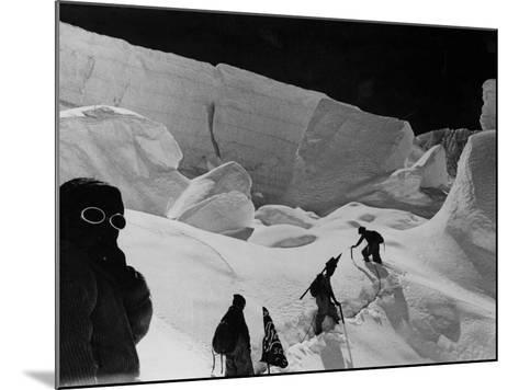 Alpinists Walking in the Snow--Mounted Photographic Print