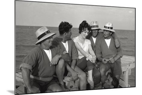 Gina Lollobrigida on the Seashore with Lifeguards--Mounted Photographic Print