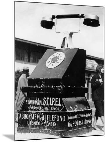 An Advertising Campaign at the Trade Fair in Milan--Mounted Photographic Print