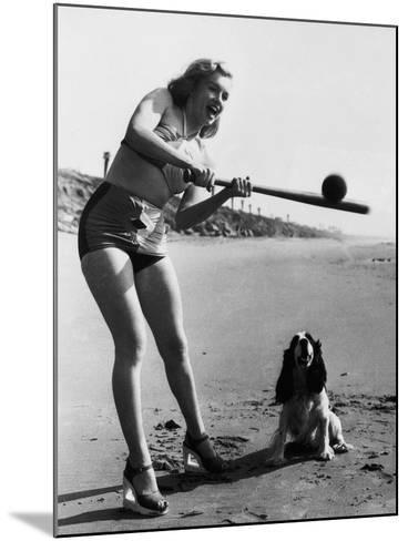Marilyn Monroe Playing Softball--Mounted Photographic Print
