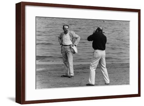Tonino Guerra Poses before a Photographer at the Seaside--Framed Art Print