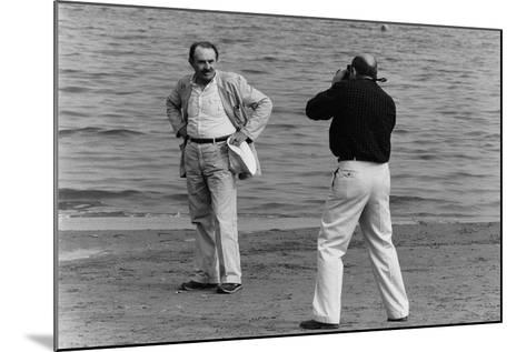 Tonino Guerra Poses before a Photographer at the Seaside--Mounted Photographic Print