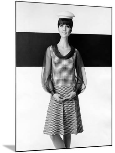 A Model Poses in a High-fashion Dress--Mounted Photographic Print