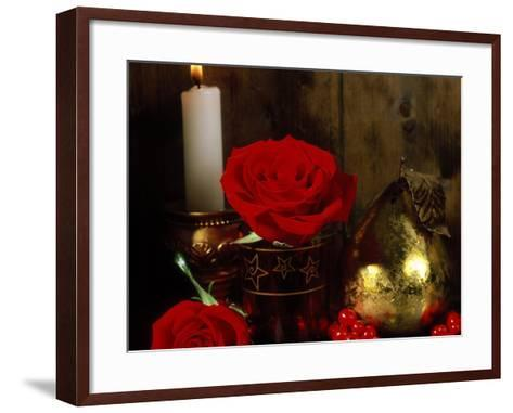 Lit White Candle in Gold Holder with Two Red Roses, Ilex Berries & Gold Pear Christmas Ornament-James Guilliam-Framed Art Print