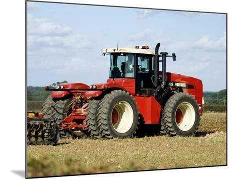 4 Wheel Drive Tractor Pulling a Disc Harrow, Cotswolds, England-Martin Page-Mounted Photographic Print