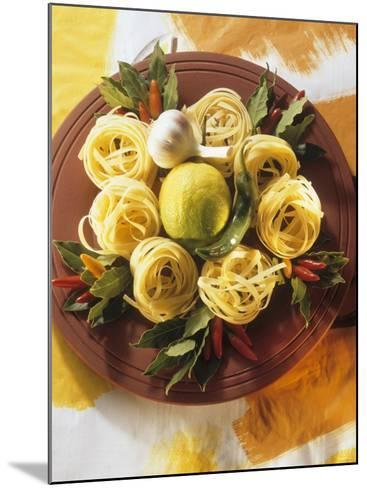Raw Noodle Nests with Lime Chilis and Bay Leaves--Mounted Photographic Print