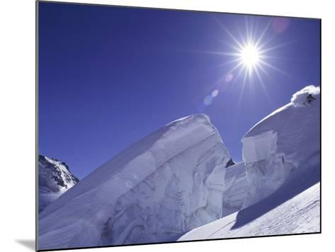 Low Angle View of a Man Skiing--Mounted Photographic Print