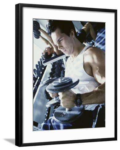 Young Man Exercising with Dumbbells--Framed Art Print