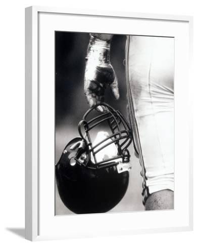 Low Angle View of An American Football Player Holding a Helmet--Framed Art Print