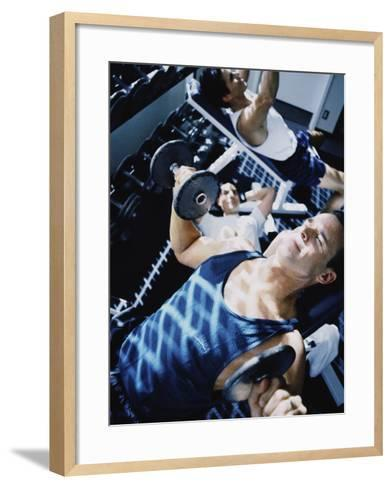 Three Young Men Exercising in a Gym--Framed Art Print