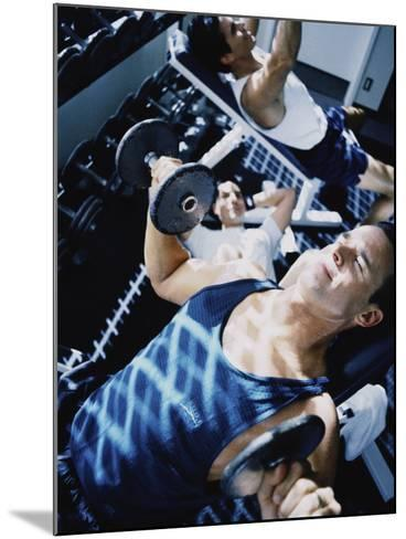 Three Young Men Exercising in a Gym--Mounted Photographic Print