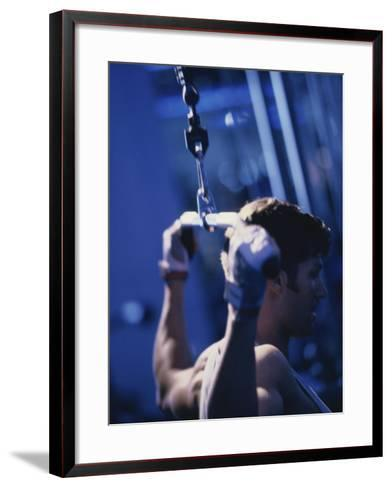 Young Man Exercising on a Lateral Pull-Down Weight Machine--Framed Art Print