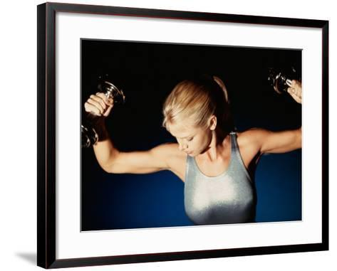 Young Woman Exercising with Dumbbells--Framed Art Print