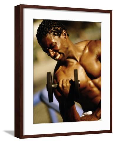 Young Man Exercising with a Dumbbell--Framed Art Print