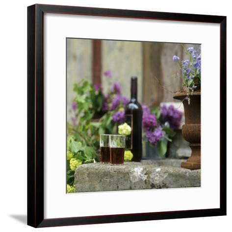 Red Wine Glasses & Red Wine Bottle on Stone Trough with Flowers-Christine Gill?-Framed Art Print