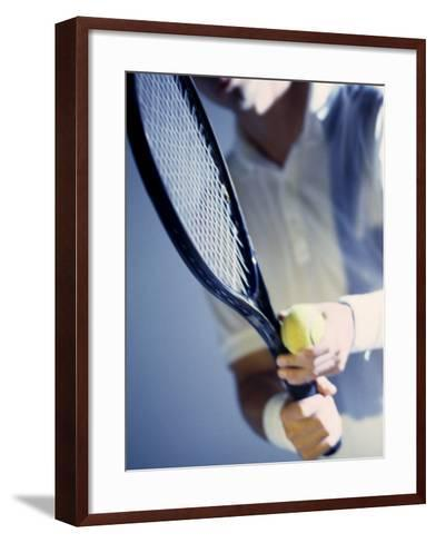 Close-up of a Young Man Holding a Tennis Racket and a Tennis Ball--Framed Art Print