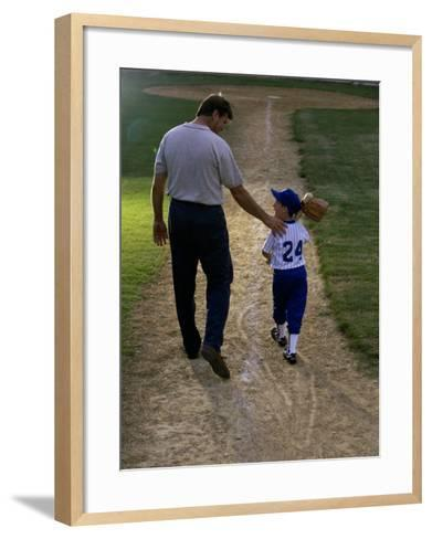 Rear View of a Man Walking with His Son at a Playing Field--Framed Art Print