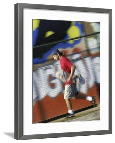 Young Man Running with Skateboard--Framed Art Print