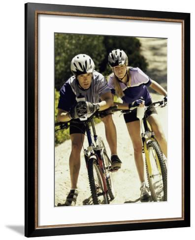 Portrait of a Young Couple Sitting on Bicycles--Framed Art Print