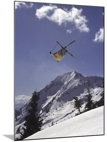 Low Angle View of a Skier in Mid Air--Mounted Photographic Print