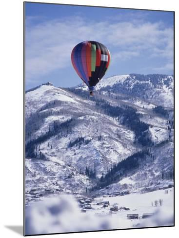 Colorful Hot Air Balloon Against Winter Landscape--Mounted Photographic Print