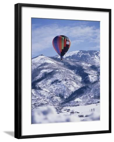 Colorful Hot Air Balloon Against Winter Landscape--Framed Art Print