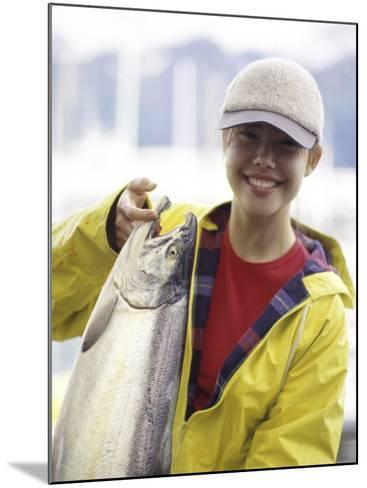Teen Girl Holding a Fish--Mounted Photographic Print