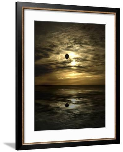 Silhouette of a Hot Air Balloon Over Water--Framed Art Print