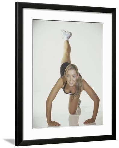 Portrait of a Young Woman Stretching--Framed Art Print