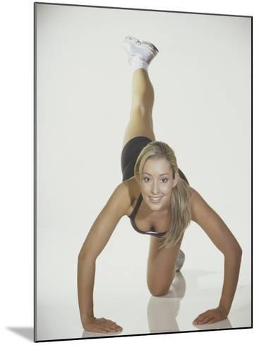 Portrait of a Young Woman Stretching--Mounted Photographic Print
