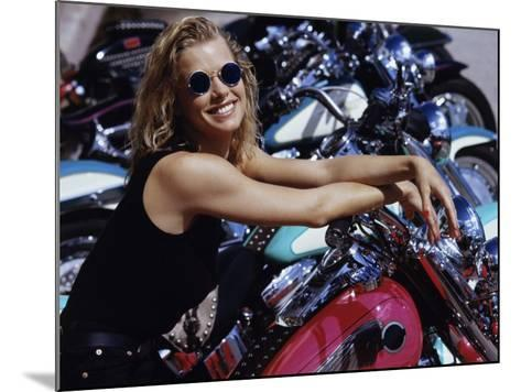 Smiling Blonde with Motorcycles--Mounted Photographic Print