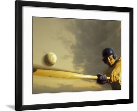 Baseball Player Swinging a Bat--Framed Art Print
