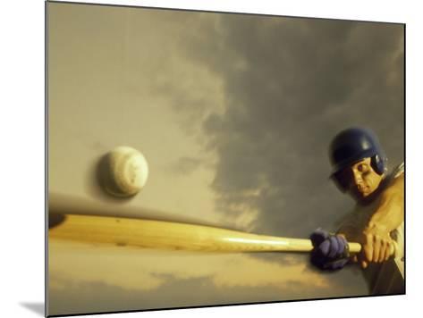 Baseball Player Swinging a Bat--Mounted Photographic Print