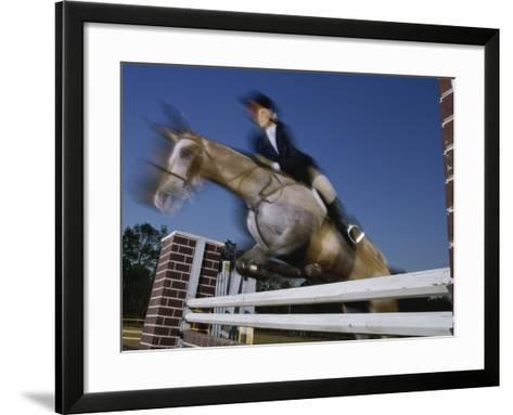 Low Angle View of a Woman Riding a Horse Over a Hurdle--Framed Art Print