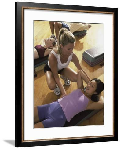 High Angle View of a Group of People Exercising in a Step Aerobics Class--Framed Art Print
