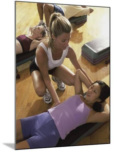 High Angle View of a Group of People Exercising in a Step Aerobics Class--Mounted Photographic Print