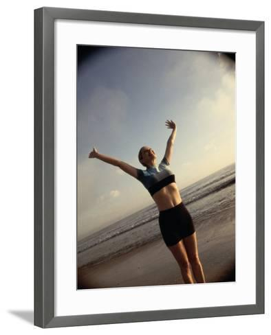 Young Woman Exercising on the Beach--Framed Art Print