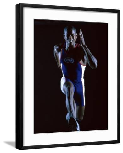Close-up of a Young Man Running--Framed Art Print