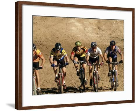 Group of People Riding Bicycles in a Race--Framed Art Print