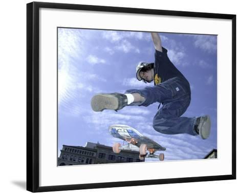 Skateboarder in Midair Doing a Trick--Framed Art Print