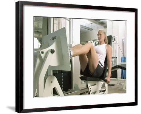 Young Woman Exercising on a Machine in a Gym--Framed Art Print