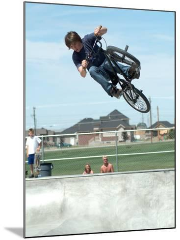 Performing a Bicycle Stunt--Mounted Photographic Print