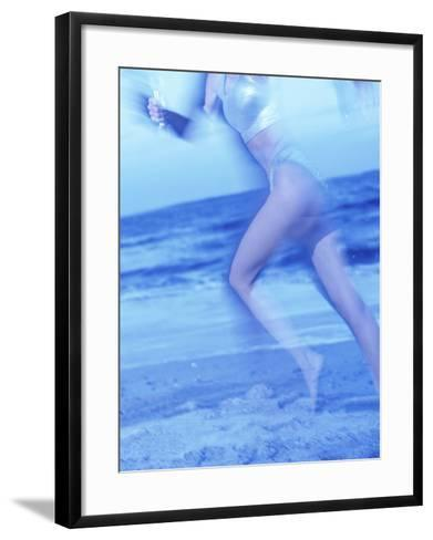 Side Profile of a Woman Running on the Beach--Framed Art Print