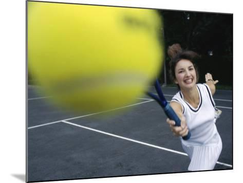 Close-up of a Young Woman Playing Tennis--Mounted Photographic Print