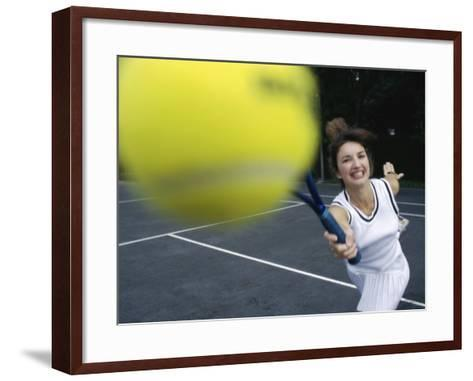 Close-up of a Young Woman Playing Tennis--Framed Art Print