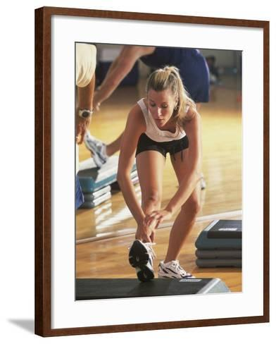 Young Woman Exercising in a Step Aerobics Class--Framed Art Print